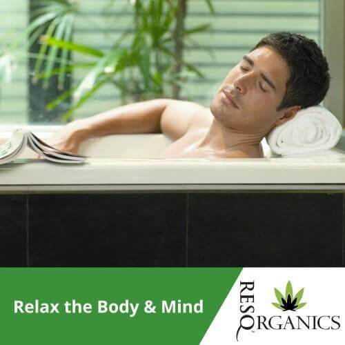 A handsome man relaxes in cbd-infused hot bath
